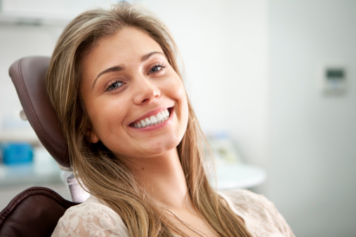 A woman smiling after receiving a gum lift at Neil Starr, DDS, PC in Washington DC,